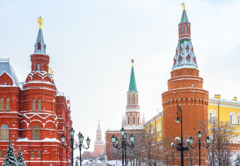 Fototapete - Moscow city center in winter, Russia. Manezhnaya Square overlooking Red Square, famous landmark of Moscow. Ancient towers of Moscow Kremlin during snowfall. Scenery of old Moscow buildings under snow.