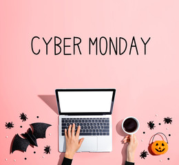 Cyber Monday banner with laptop and Halloween decorations - flat lay