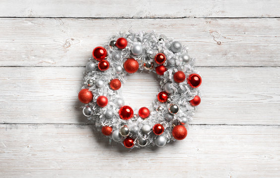 Christmas Wreath on White Wooden Background, Hanging Decoration on Holiday Wood Planks Wall