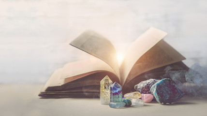 mystical composition with minerals and crystals and ancient book. study of properties of minerals and rocks, practice spells. Crystal Ritual, Witchcraft. shallow depth. grunge filter, soft focus