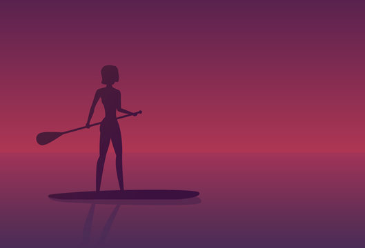 Girl on a sup board at sunset
