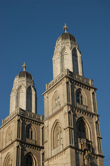 The twin bell towers of the Grossmünster church in Zurich, Switzerland on a background of clear blue sky
