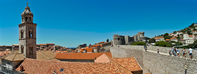 Rooftops in Dubrovnik's Old City with the city wall and the Dominican monastery