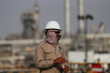 An employee looks on at Saudi Aramco oil facility in Abqaiq