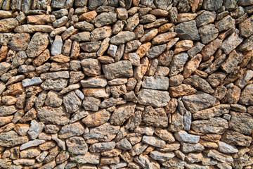 Wall of broken natural stones