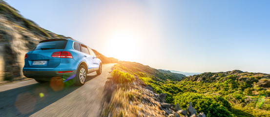 Poster Blue sky SUV car in spain mountain landscape road at sunset