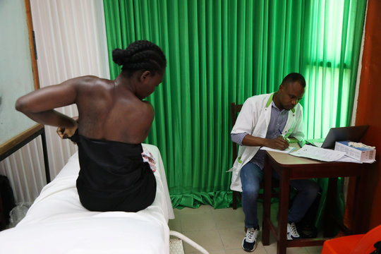 A woman prepares for a screening during the breast cancer prevention campaign in Abidjan, Ivory Coast