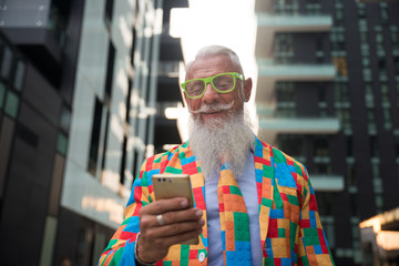 Youthful stylish senior man with hipster outfit