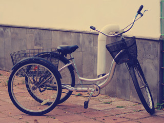 Aluminium Prints Bicycle Tricycle for adults in the city, vintage toned