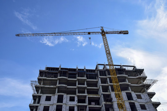 Construction of a new residential building  with use of tower crane. Real Estate, Residential Buildings Urban Mixed-Use Development Concept.
