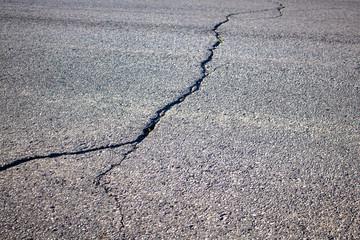 Cracked Asphalt on a Paved Road