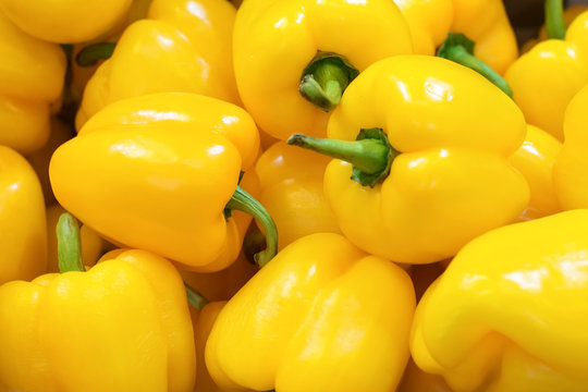 Fresh yellow peppers, closeup background.