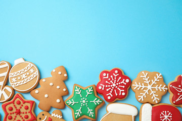 Fotobehang - Flat lay composition with tasty homemade Christmas cookies on light blue background, space for text