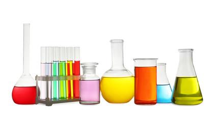 Fototapete - Laboratory glassware with colorful liquids on white background