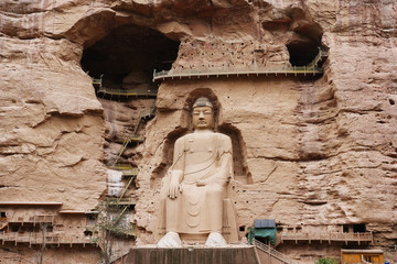 Ancient Chinese Buddha Statue at Bingling Cave Temple in Lanzhou Gansu China. UNESCO World heritage site Fotomurales