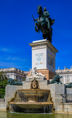 Large equestrian statue of king Philip IV in the center of the Plaza de Oriente by the Royal Palace in Madrid, Spain