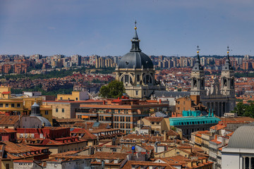Aerial view of the Madrid cityscape with Almudena Cathedral rooftops in the city center in Madrid, Spain