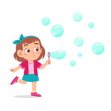 happy cute kid girl blow bubble soap