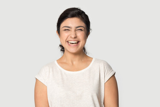 Overjoyed indian girl laugh posing on grey background