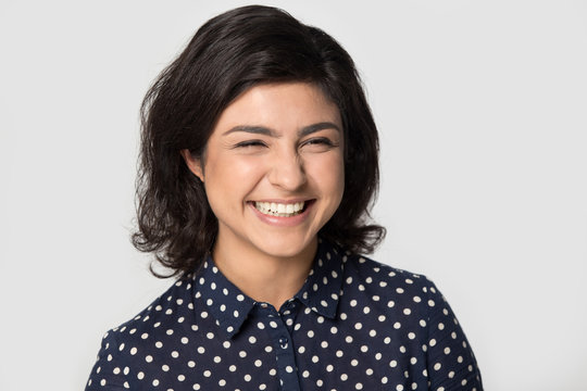 Happy indian girl posing in grey studio background
