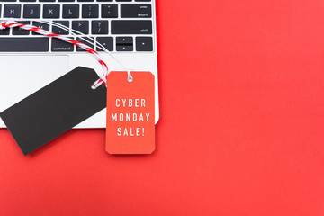 Online shopping Cyber Monday text with red tag label and Blank black red tag on laptop computer