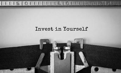 Text Invest in Yourself typed on retro typewriter