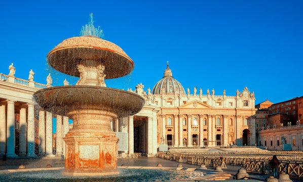 St. Peter's Basilica in Rome. Fountain of St. Peter's Square by Gian Lorenzo Bernini. Rome architecture and landmark. Italian Renaissance church.
