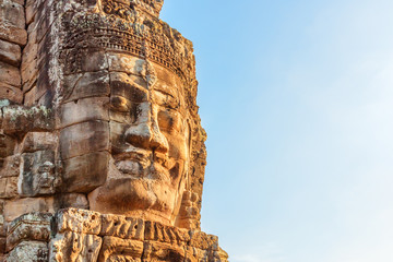 Wall Mural - Beautiful view of giant stone face of Bayon temple, Angkor