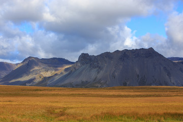 grassland and volcanic terrain
