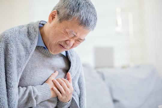 asian elderly man feel chest pain