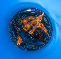 Mini planet Night Aerial view panorama of a freeway intersection traffic trails in night Moscow
