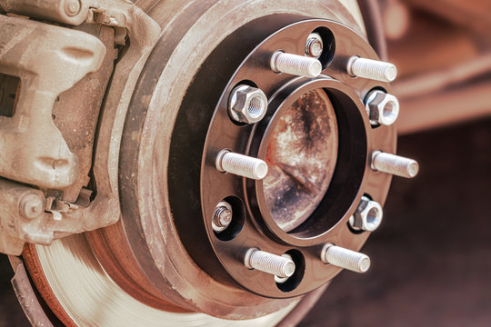 wheel spacer with studs for the car mounted on the wheel hub auto tuning, close-up