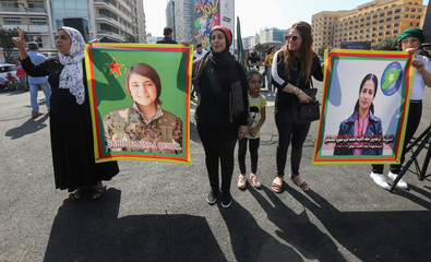 Kurds living in Lebanon pose for a picture as they protest against Turkey's military action in northeastern Syria, in Beirut