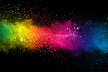 Colorful background of pastel powder explosion.Multi colored dust splash on black background.Painted Holi.