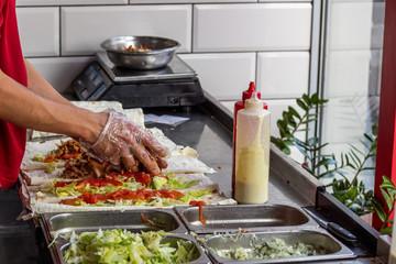 Preparation of shawarma at a fast food restaurant.