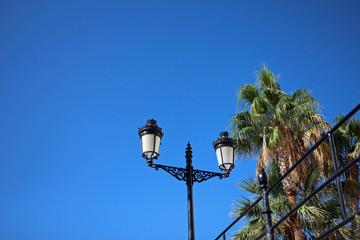 Street lamp by clear blue sky