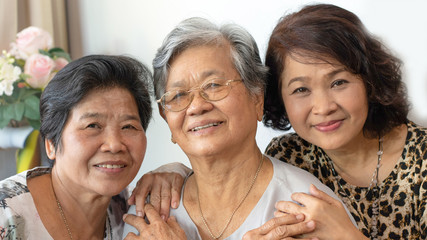 Happy senior society family concept. Portrait of Asian female older ageing women smiling with happiness at home, or wellbeing county  hospice- Image