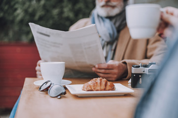 Relaxed afternoon with coffee and newspaper stock photo