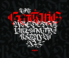 Gothic style alphabet. Vector. Letters and symbols on a black background. Calligraphy with a white marker. Medieval latin letters. Elegant font for tattoos. Ancient Germanic style.