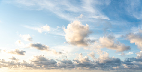 Blue sunset sky with nice white clouds Wall mural