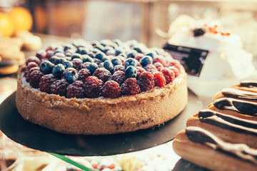 delicious cake with berries in the shop window