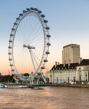 London Eye ferris wheel on bank of Thames