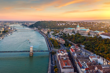 Fototapeta Amazing sunset cityscape from a part of Budapest. Main theme is the Buda Castle.