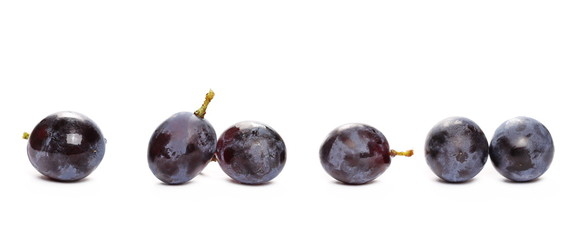 Fresh black muscat grapes isolated on white background