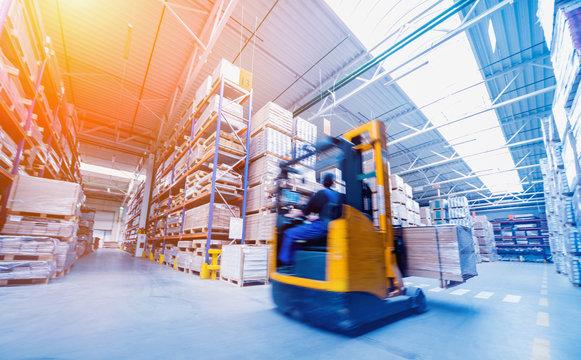 Forklift loader in storage warehouse ship yard. Distribution products. Delivery. Logistics. Transportation.