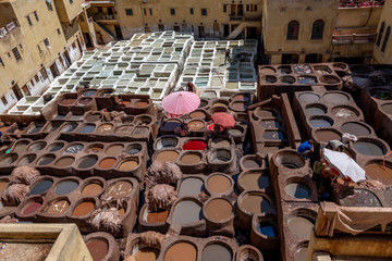Large leather tannery showing all the colors and dyes in Fez Medina Morocco