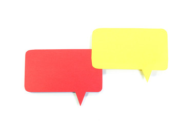Red and yellow speech bubble on white background