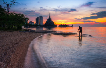 photographer take pictures Sunset and Sea View with Sanctuary of Truth Background Pattaya, Thailand