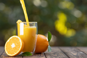 orange juice pouring in glass