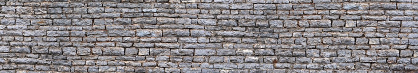 Fotobehang - Texture of a old castle stone wall masonry background.